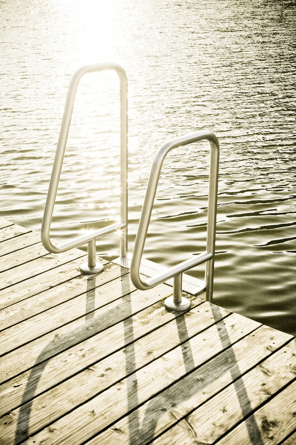 silver body of water ladder