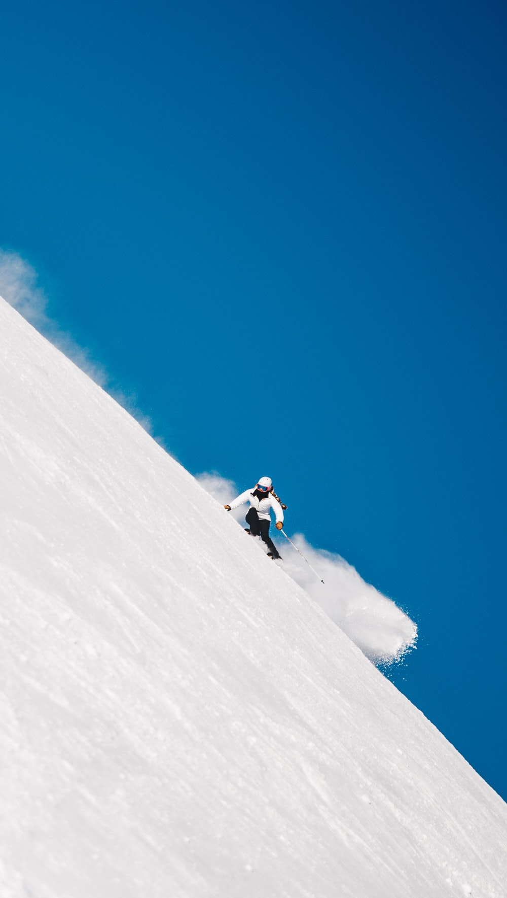 person snowboarding on mountain cliff