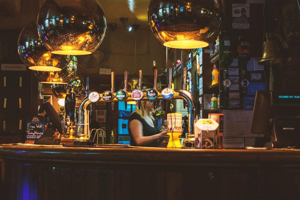 woman standing inside bar