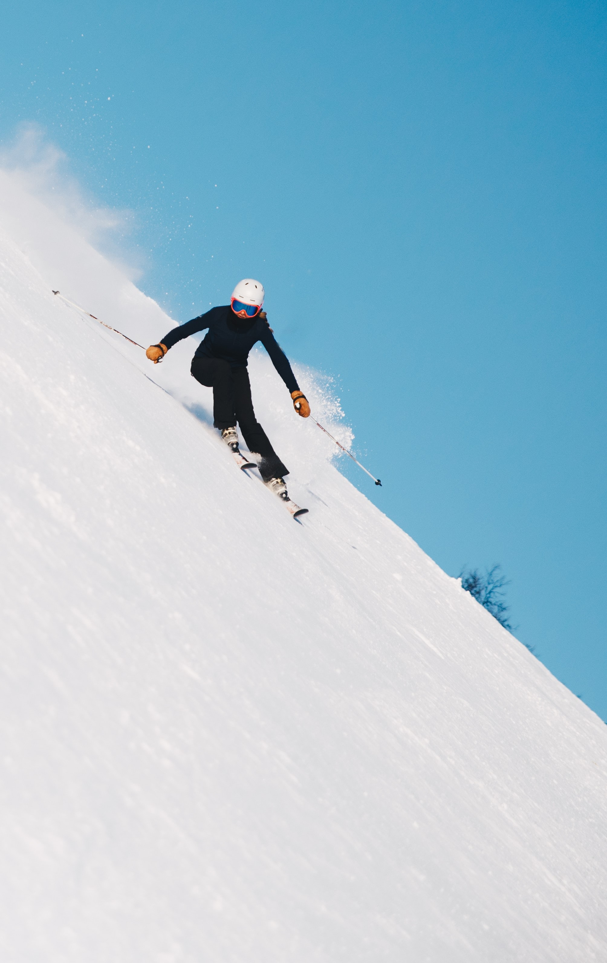 person skiing on snow with gear set