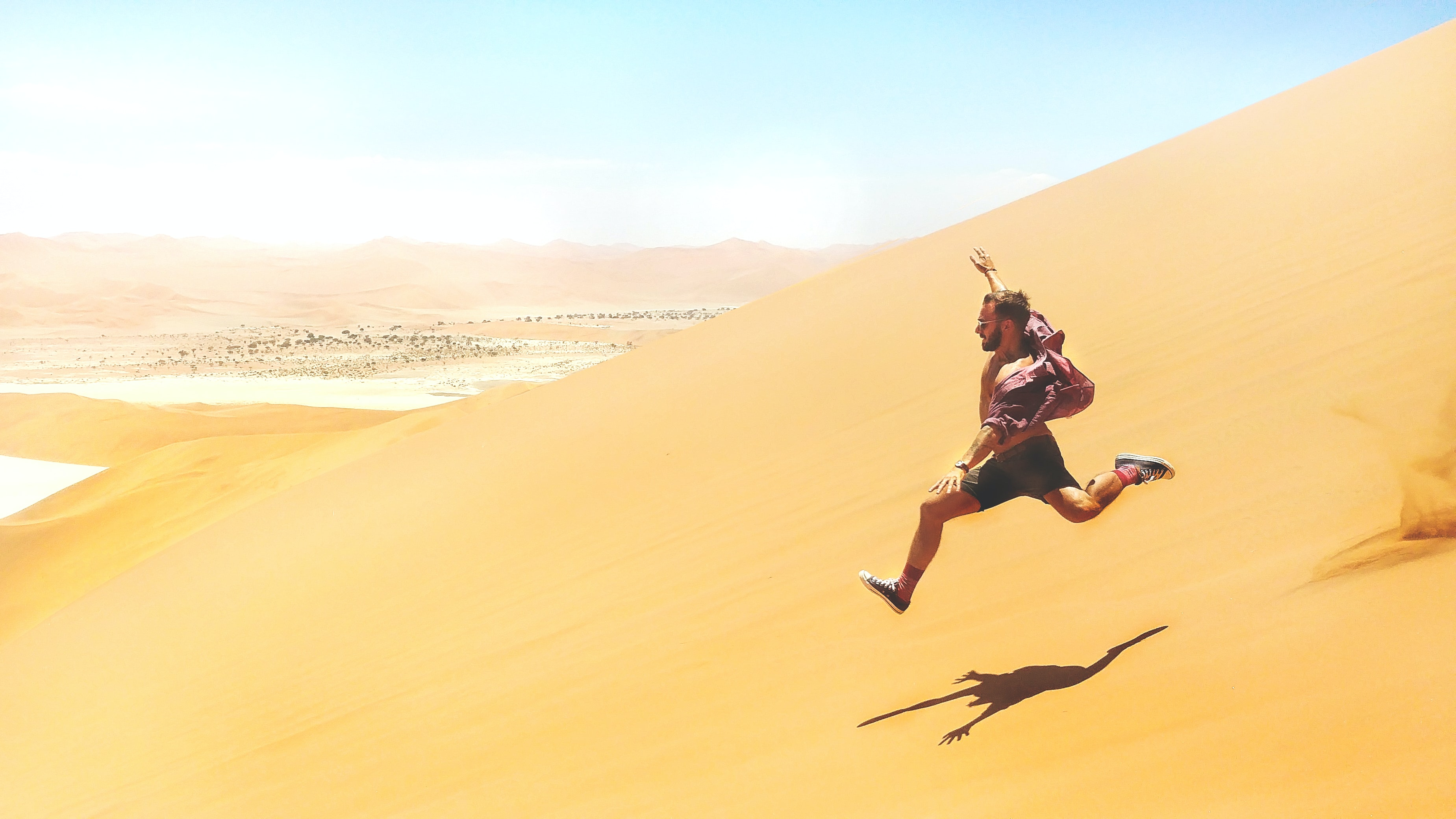 man running down on desert