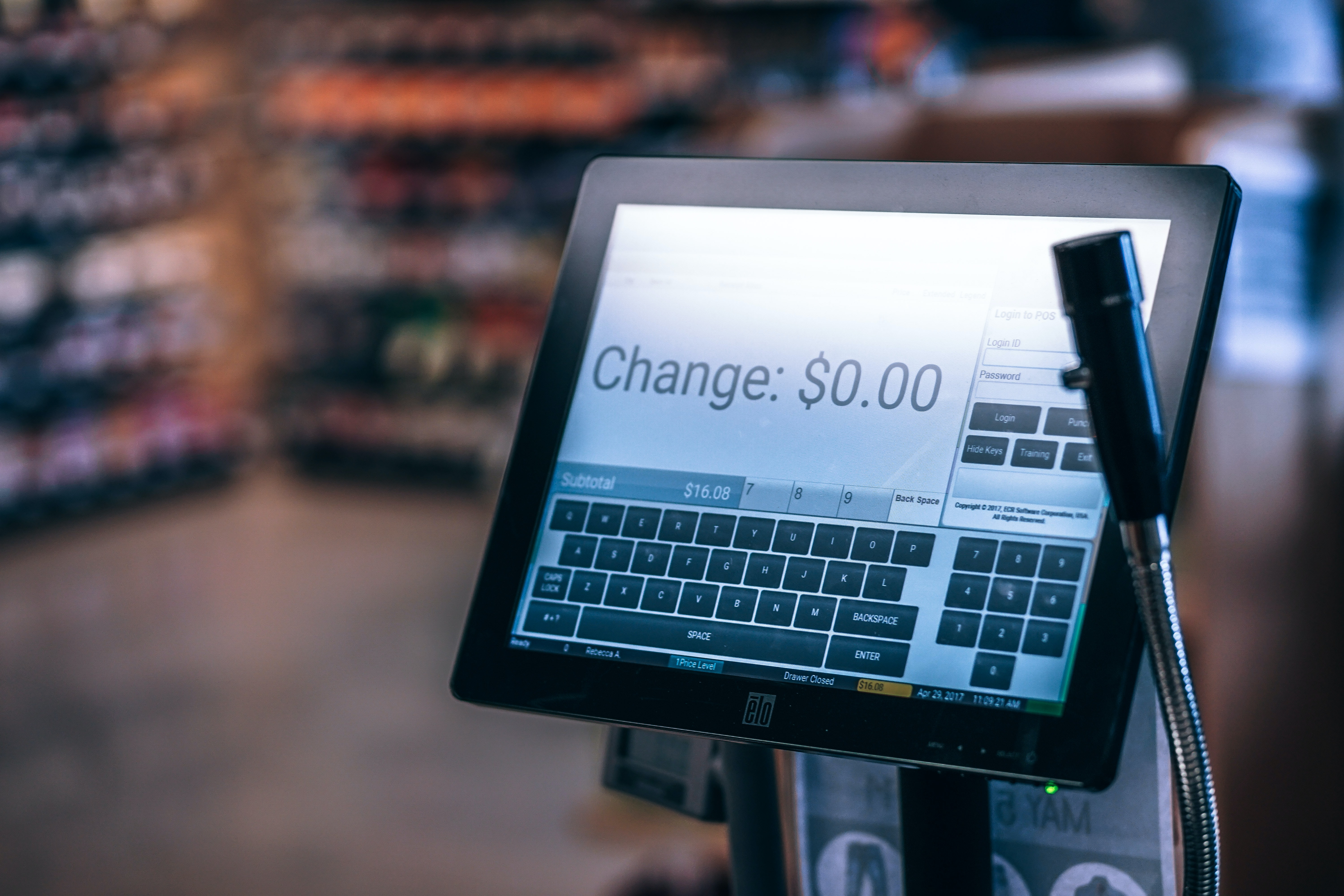 selective focus photography of cash register monitor