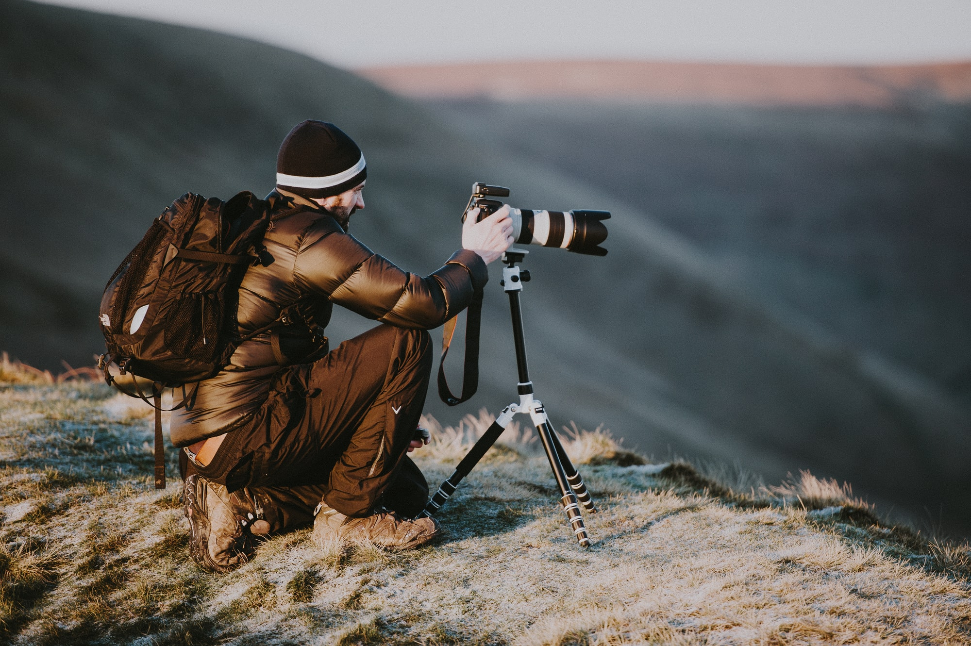 Photographer with Canon camera and tripod