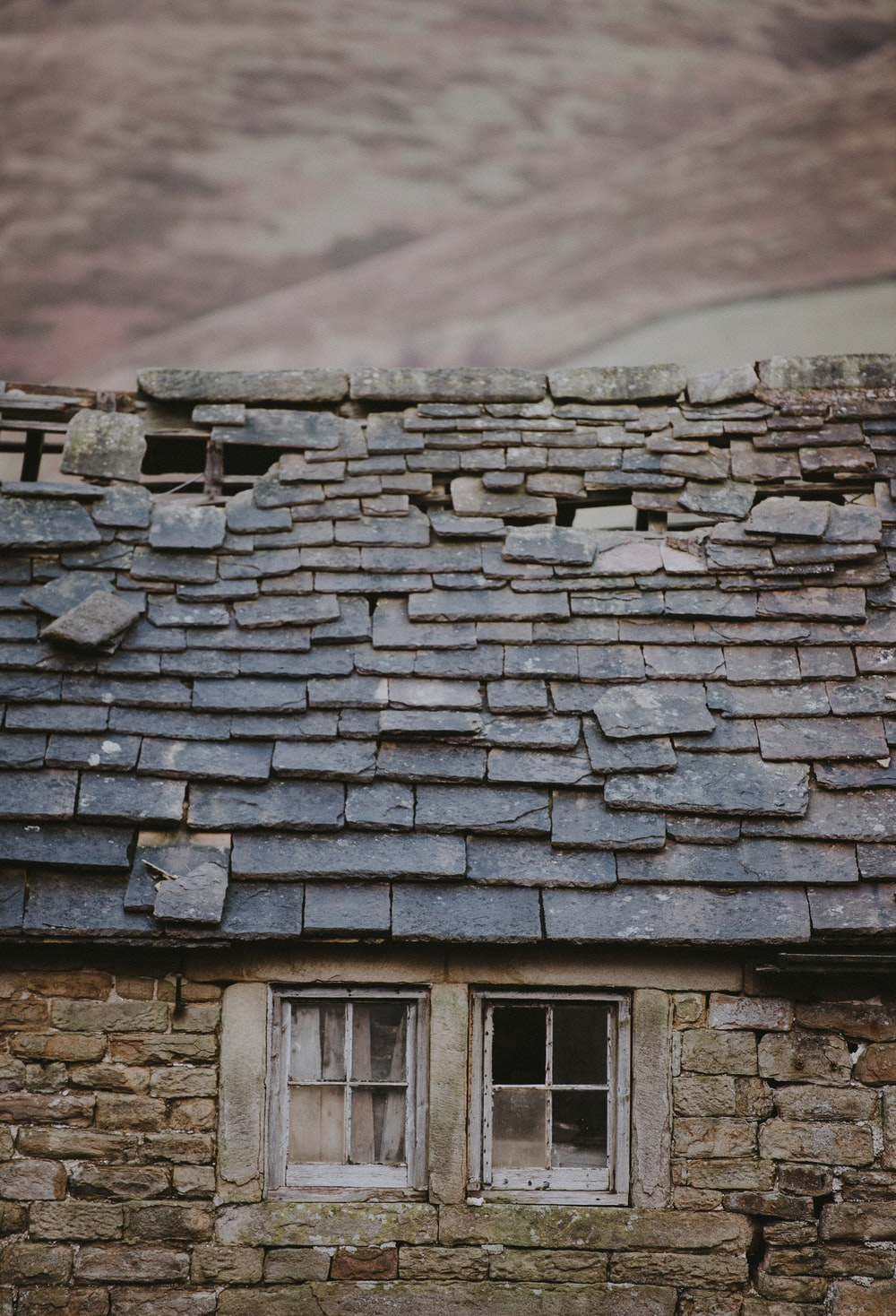 gray and brown brick wall house