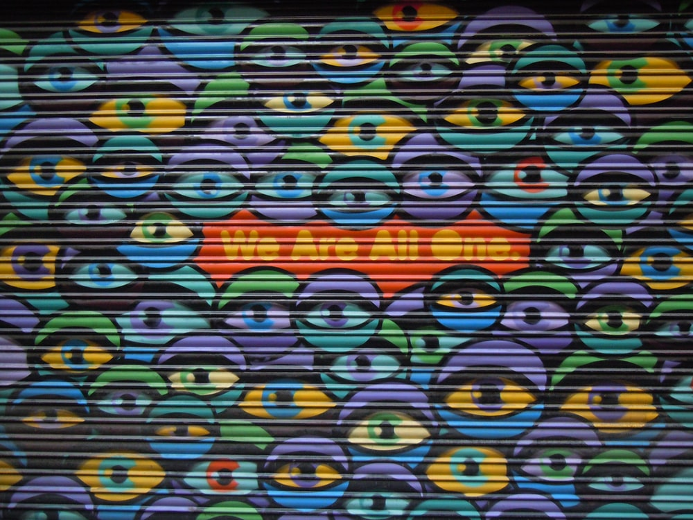 multicolored we are all one eyes printed roll-up door