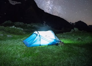 blue play tent on grass field during nighttime