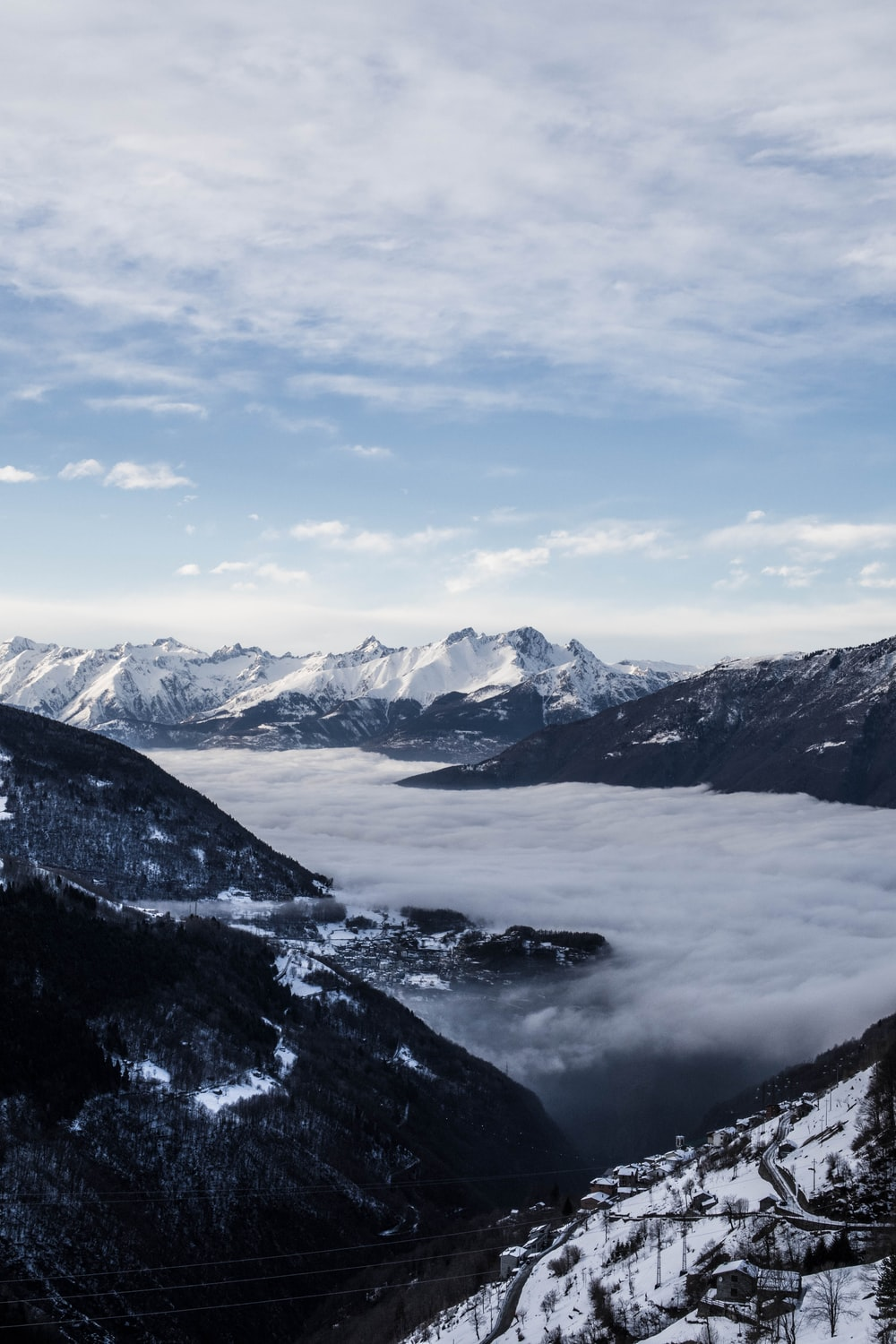 aerial photography of clouds beside mountain