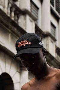 selective focus photography of man wearing cap