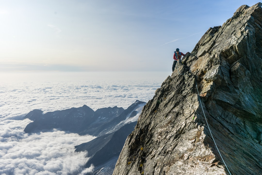 My brother traverses the ridge high on the Lagginhorn, with Italy hidden beneath the layer of clouds in the background.