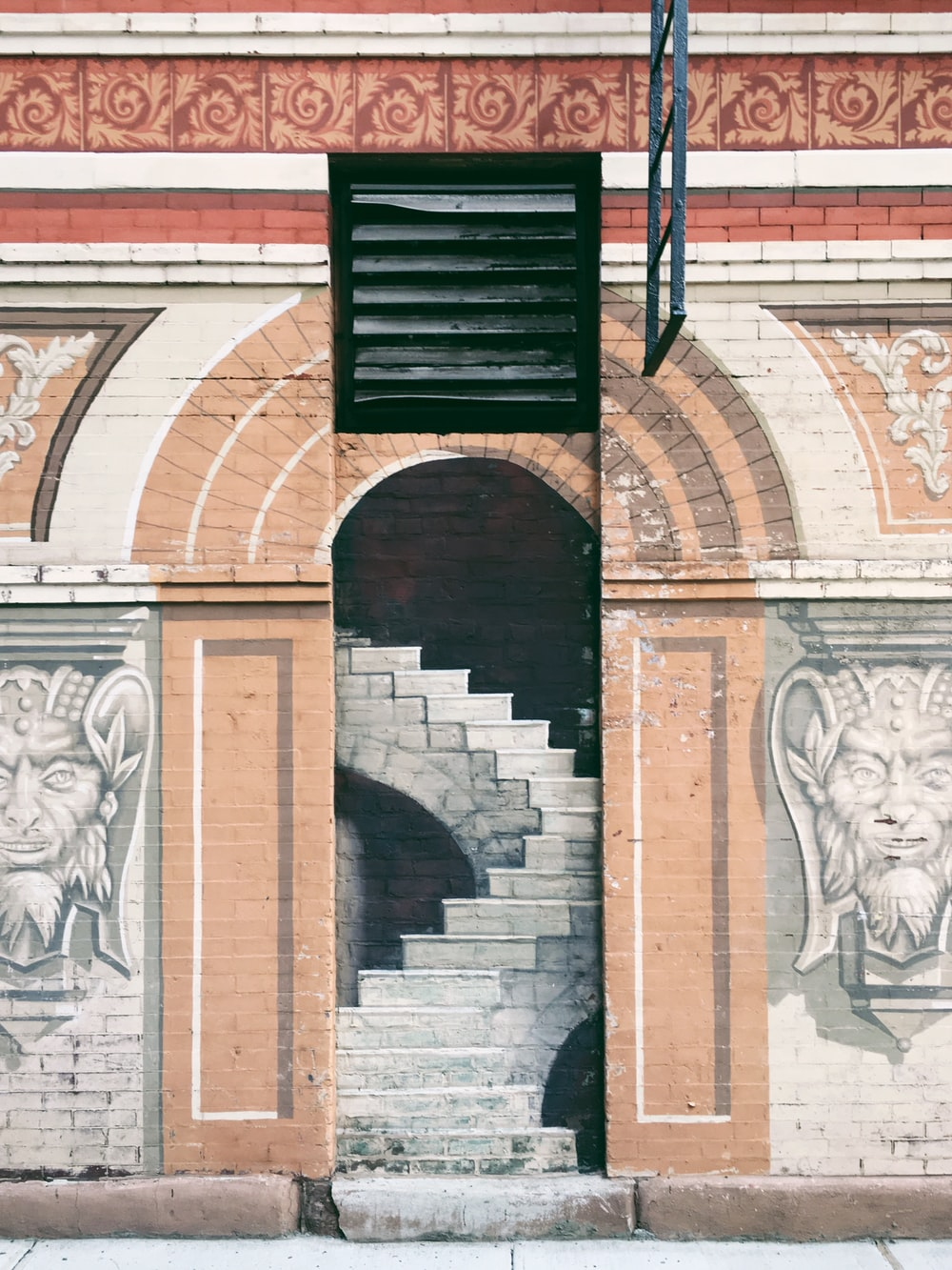 arch hallway and stair graffiti