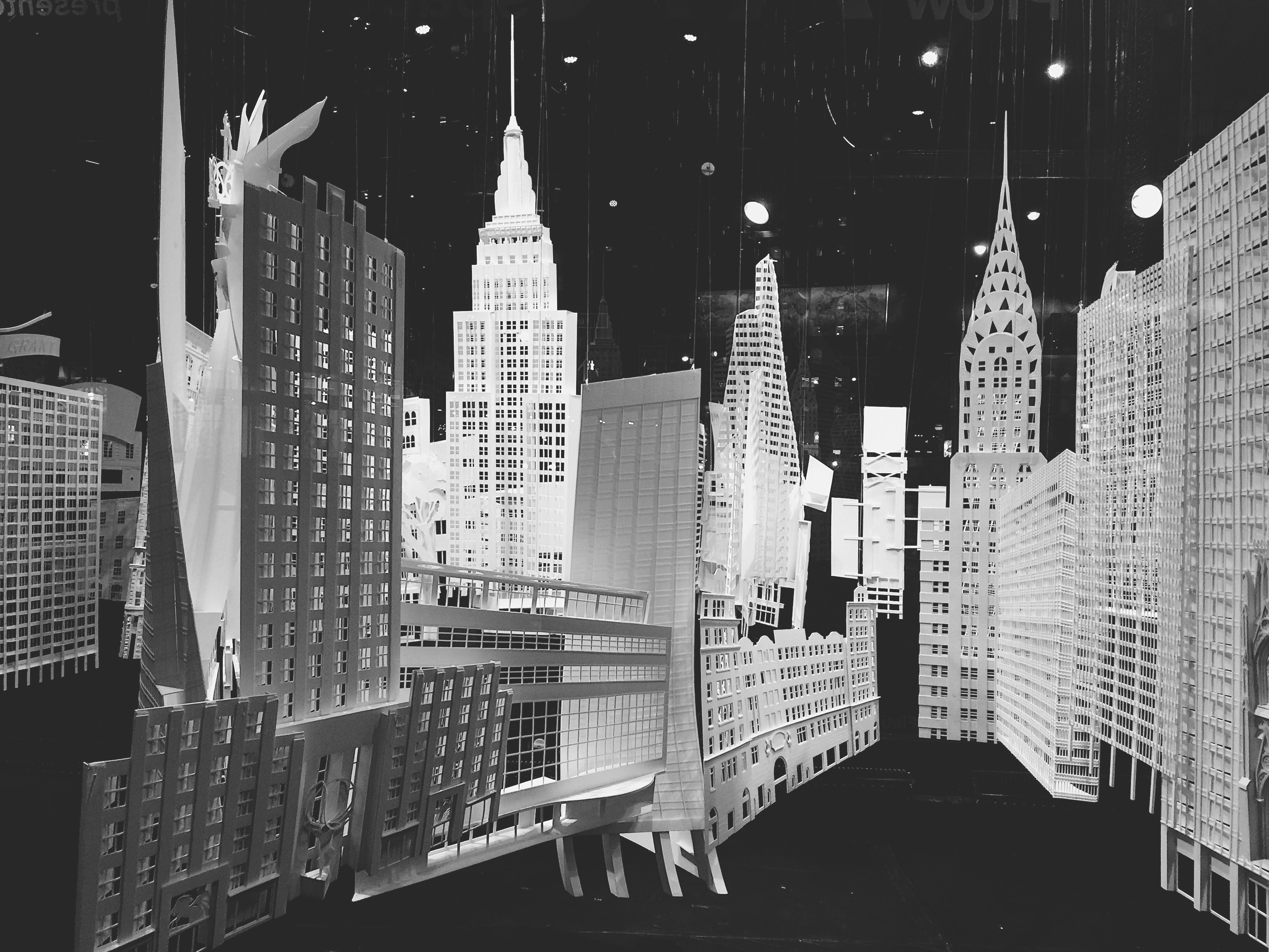 city buildings in grayscale photography