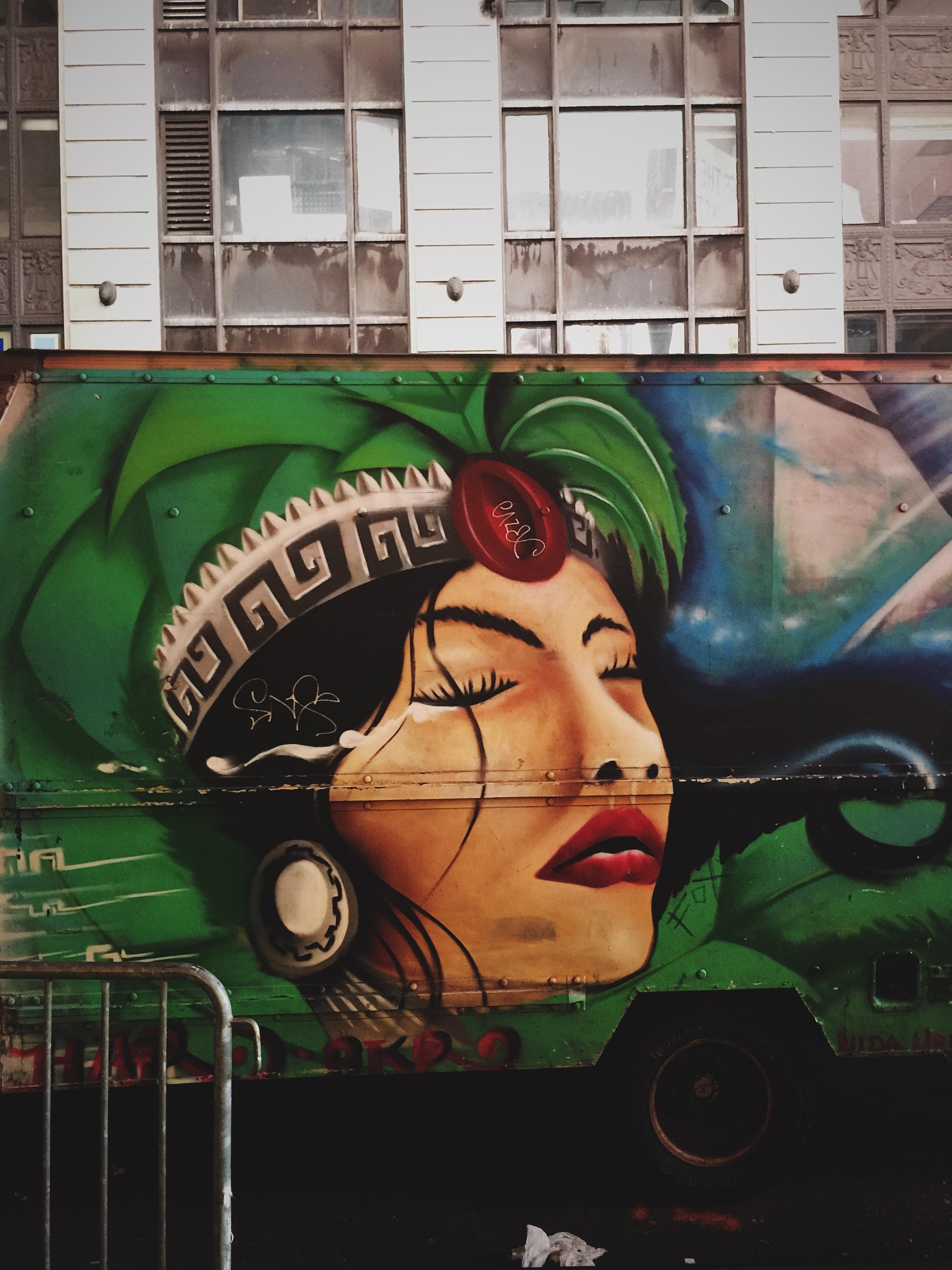 truck with graffiti near gray building