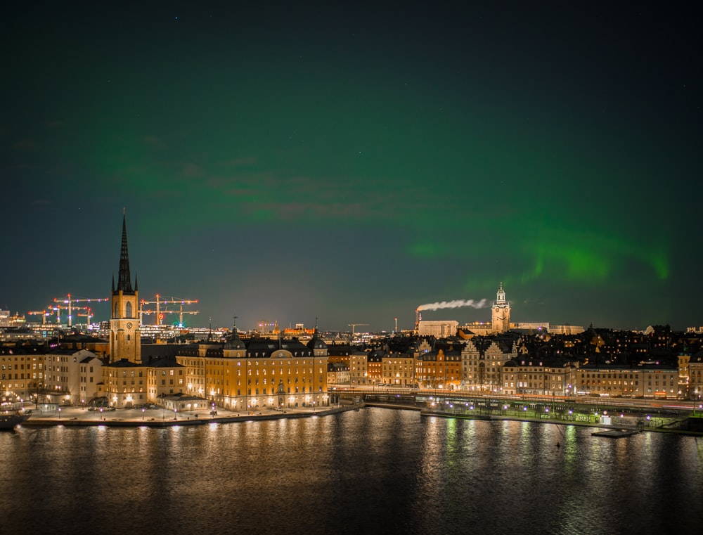 aurora sky phenomenon in cityscale near ocean
