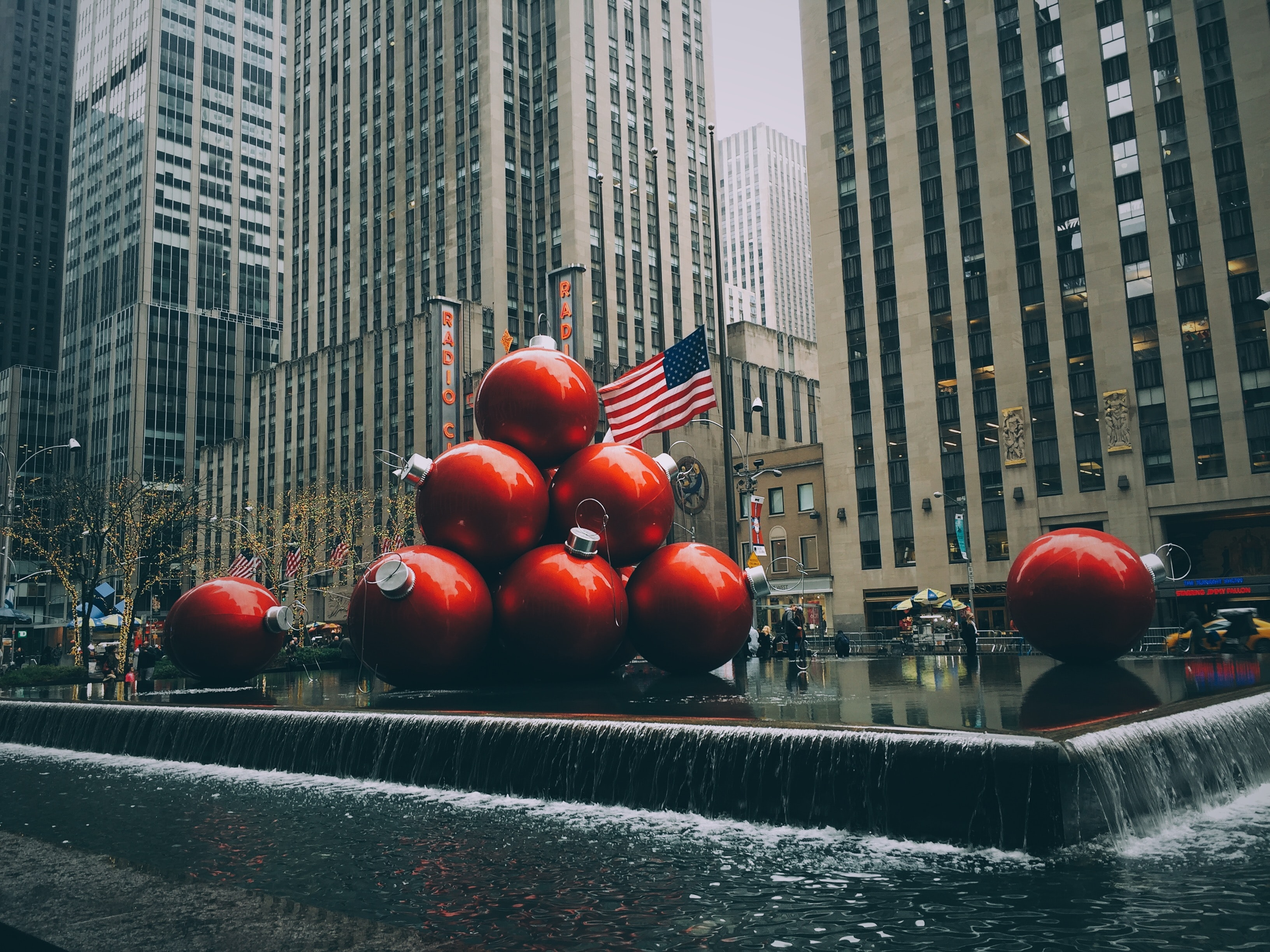red bauble fountain near buildings