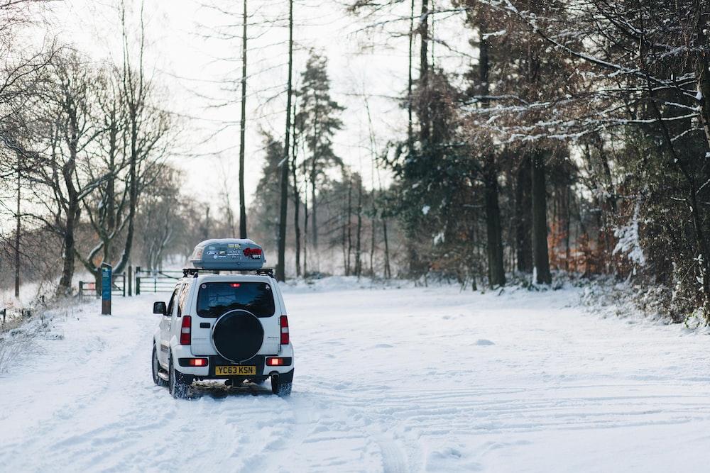 white compact van at snow path