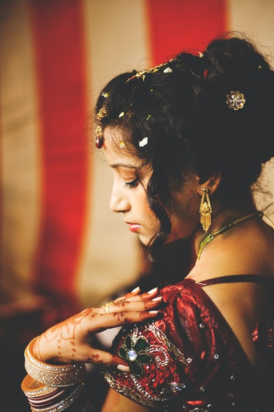 During my travels in New Delhi, I got to photograph the marriage of two of my friends. Henna is a tradition that lives on in even Christian weddings - this couple had a Christian ceremony and then changed from their western wedding outfits into traditional red Indian wedding garb. Here she is at their tented reception where she and the groom spent most of their time posing for photographs and eating amazing food!
