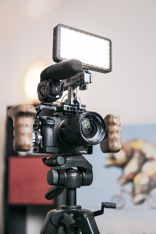 tilt shift lens photography of black Sony DSLR camera