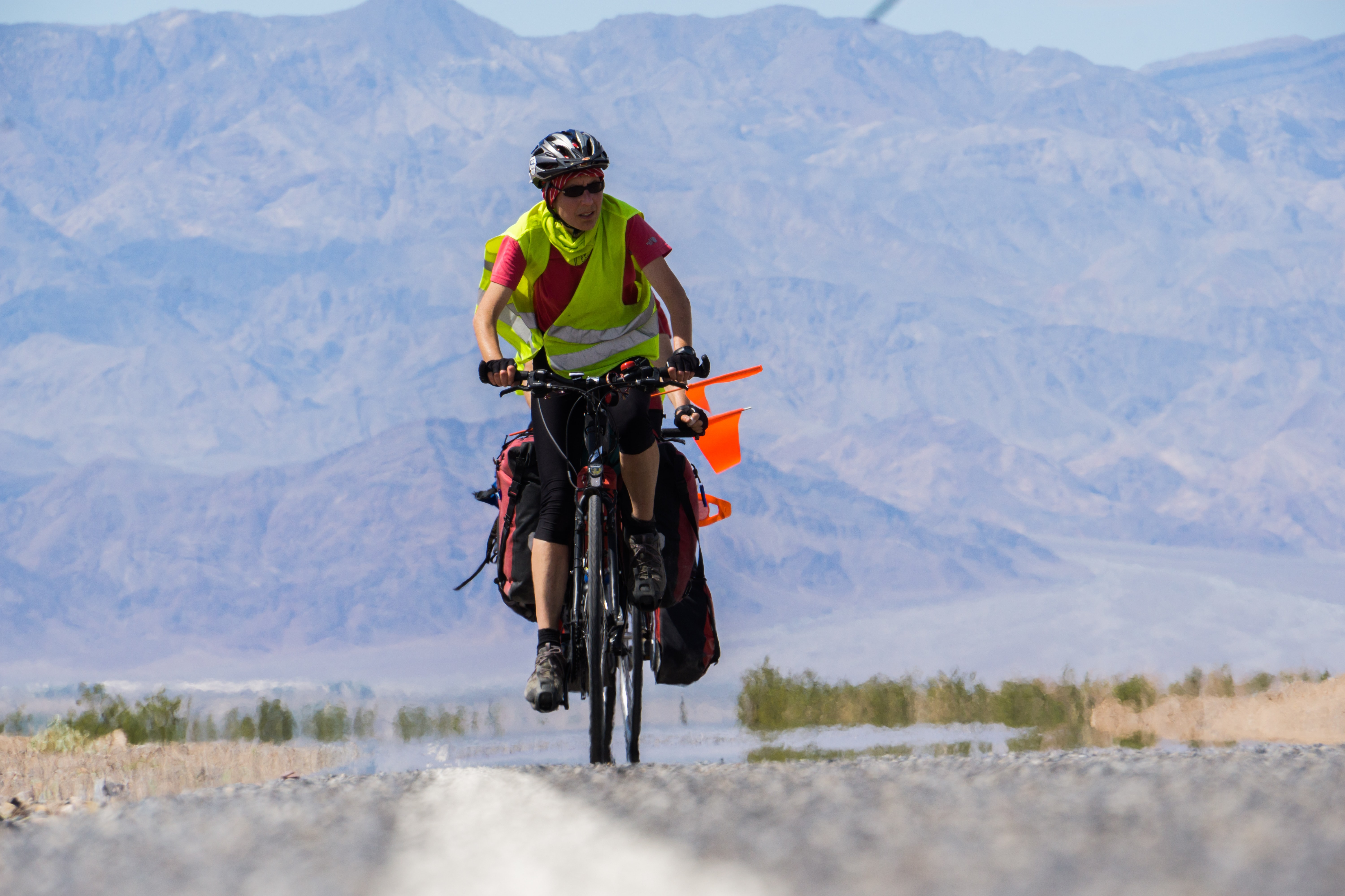 man riding bicycle against mountain