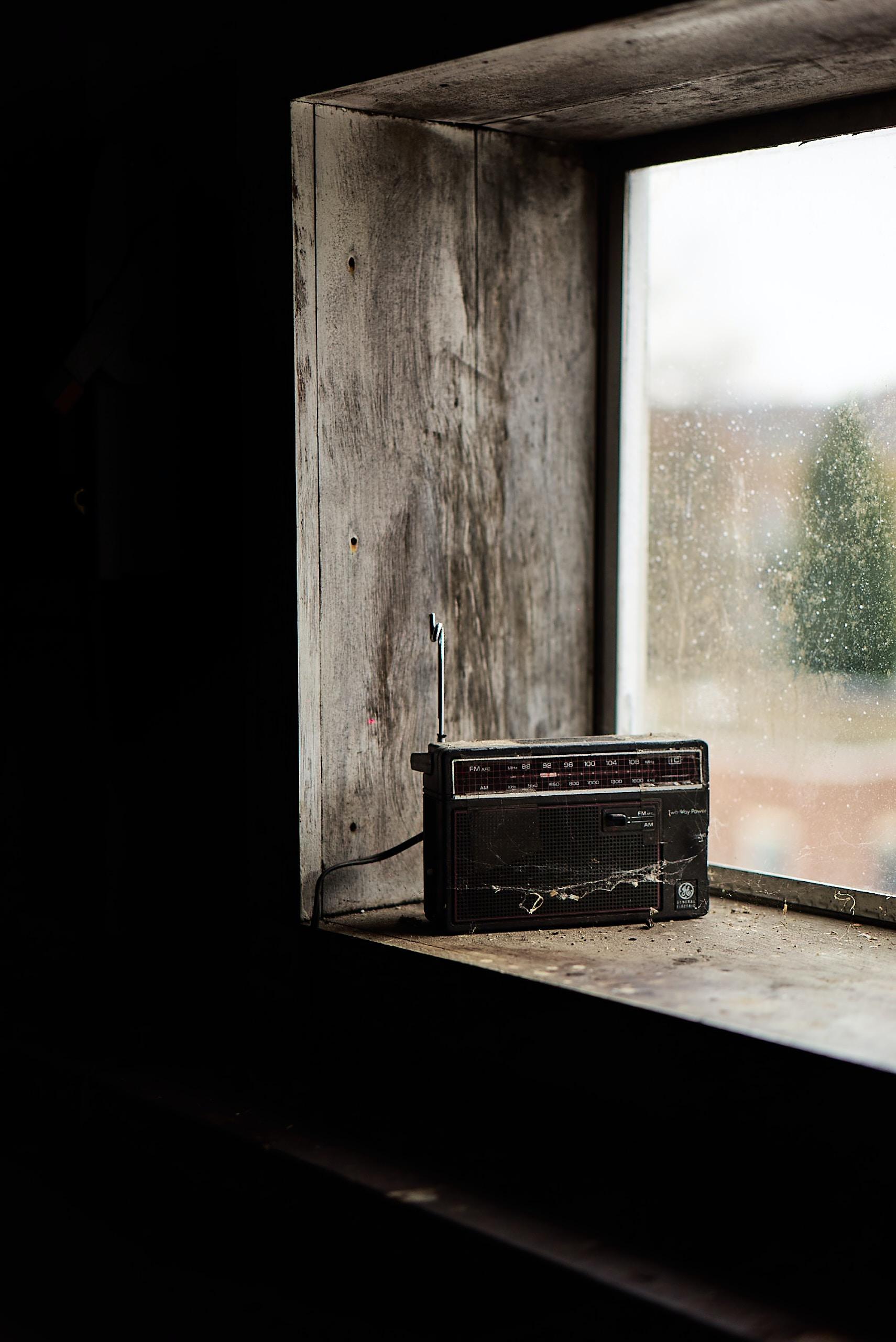 black boombox radio on top window