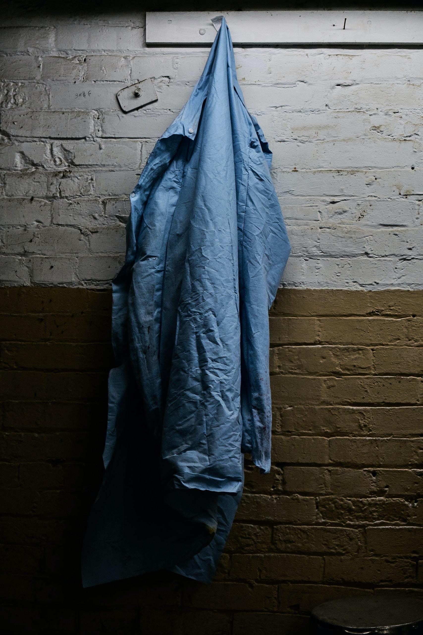 blue windbreaker hanging on hook