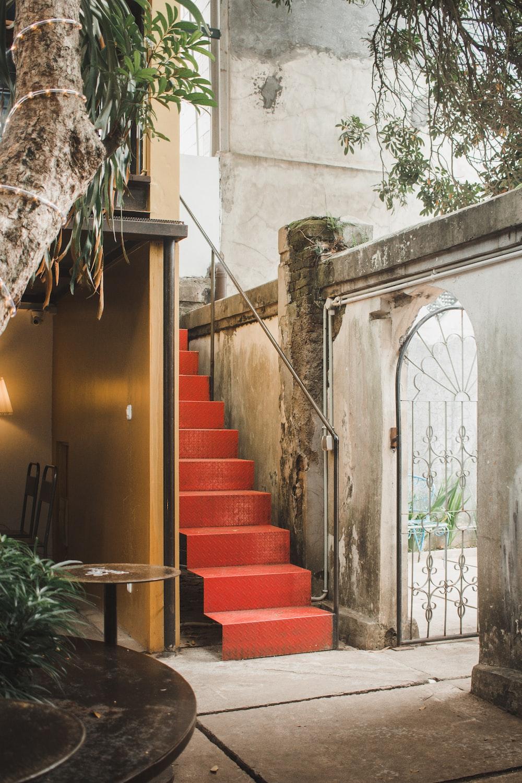 red metal stair beside building