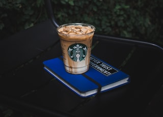 Starbucks plastic cup on blue book