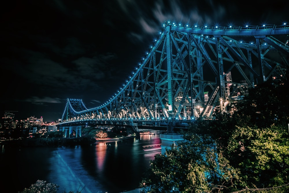gray bridge under night sky