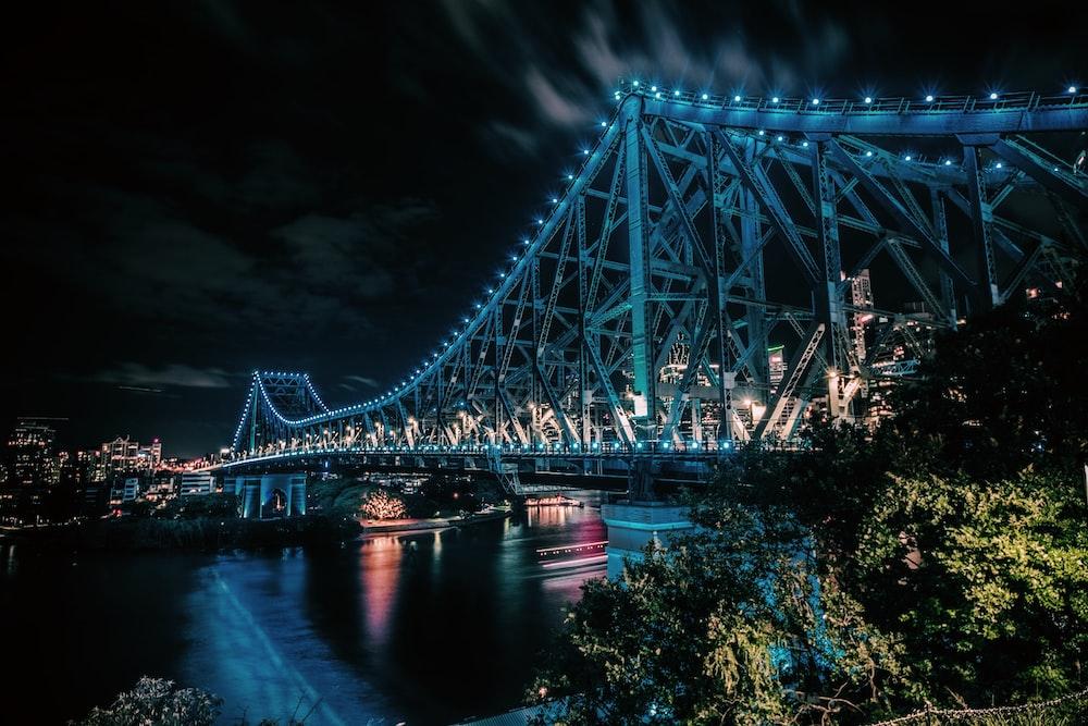 gray bridge under night sky