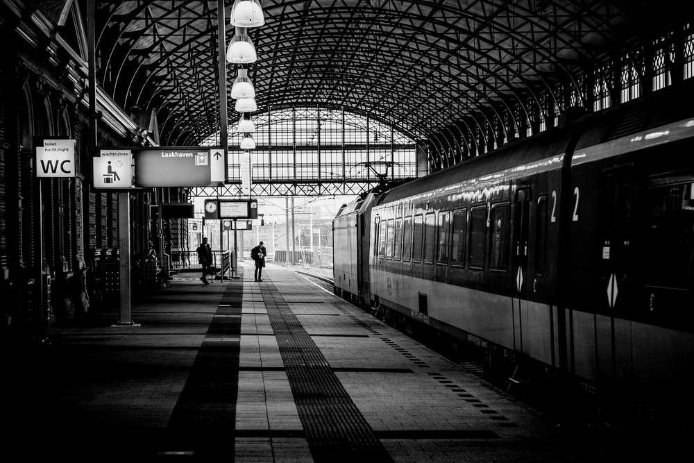 black and white photo of train on station