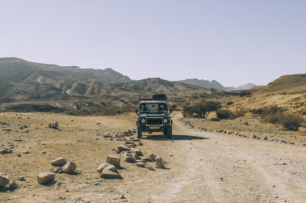gray SUV near mountain during daytime