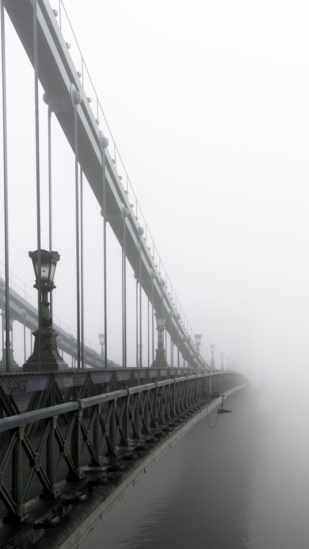 closeup photo of bridge and mist