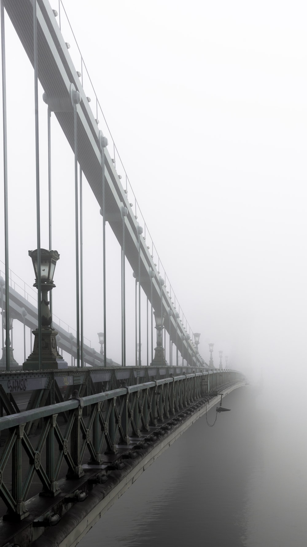 closeup photo of bridge and mist