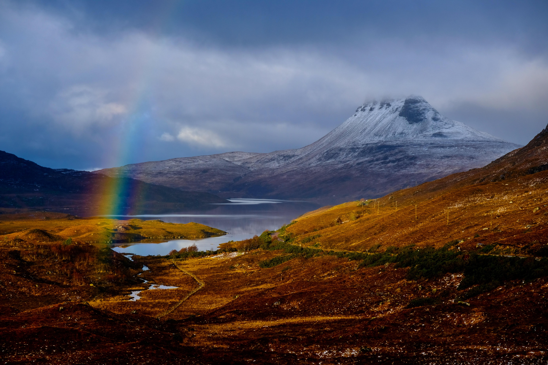 rainbow above brown field