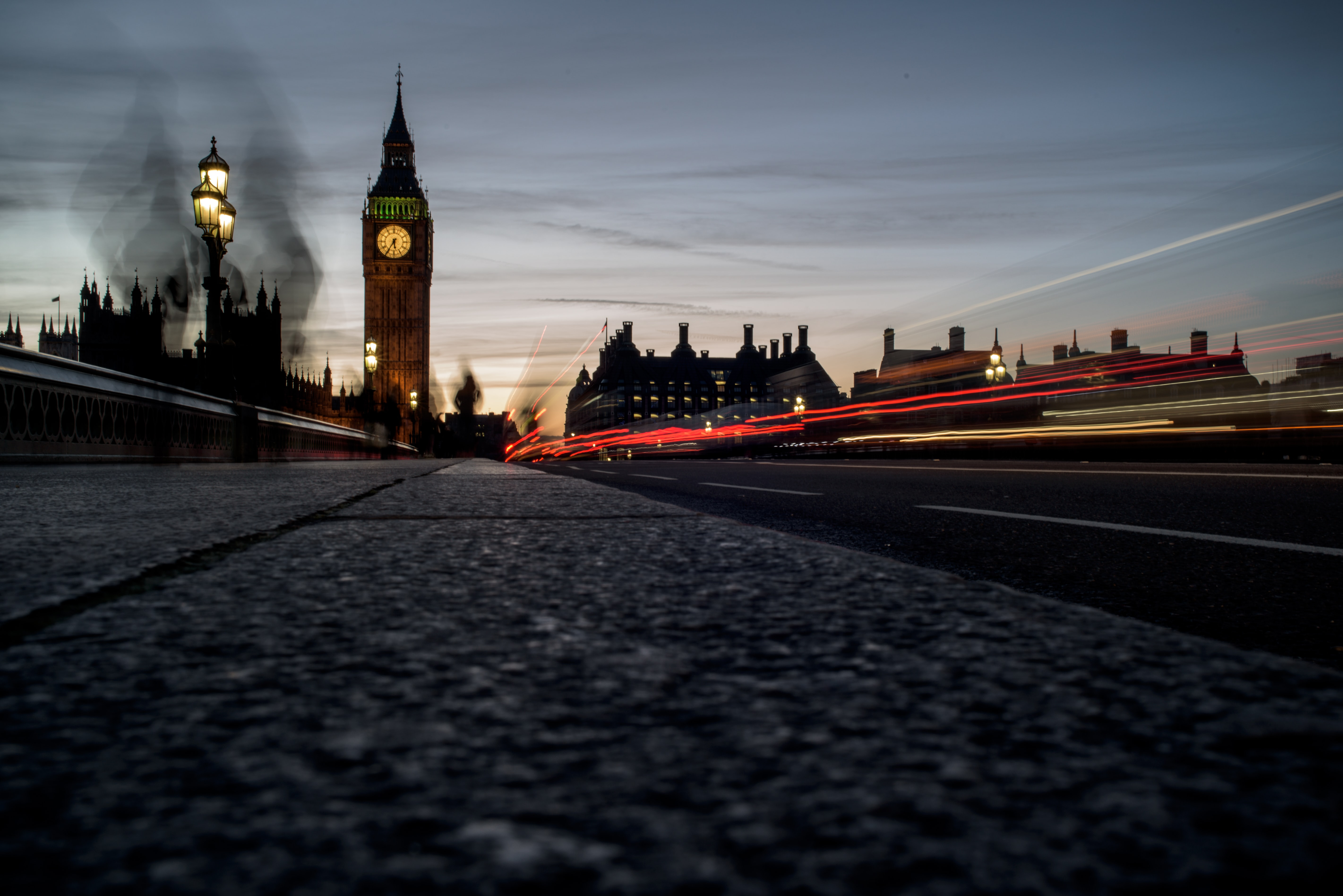 time lapse photography of street with Elizabeth Tower in background