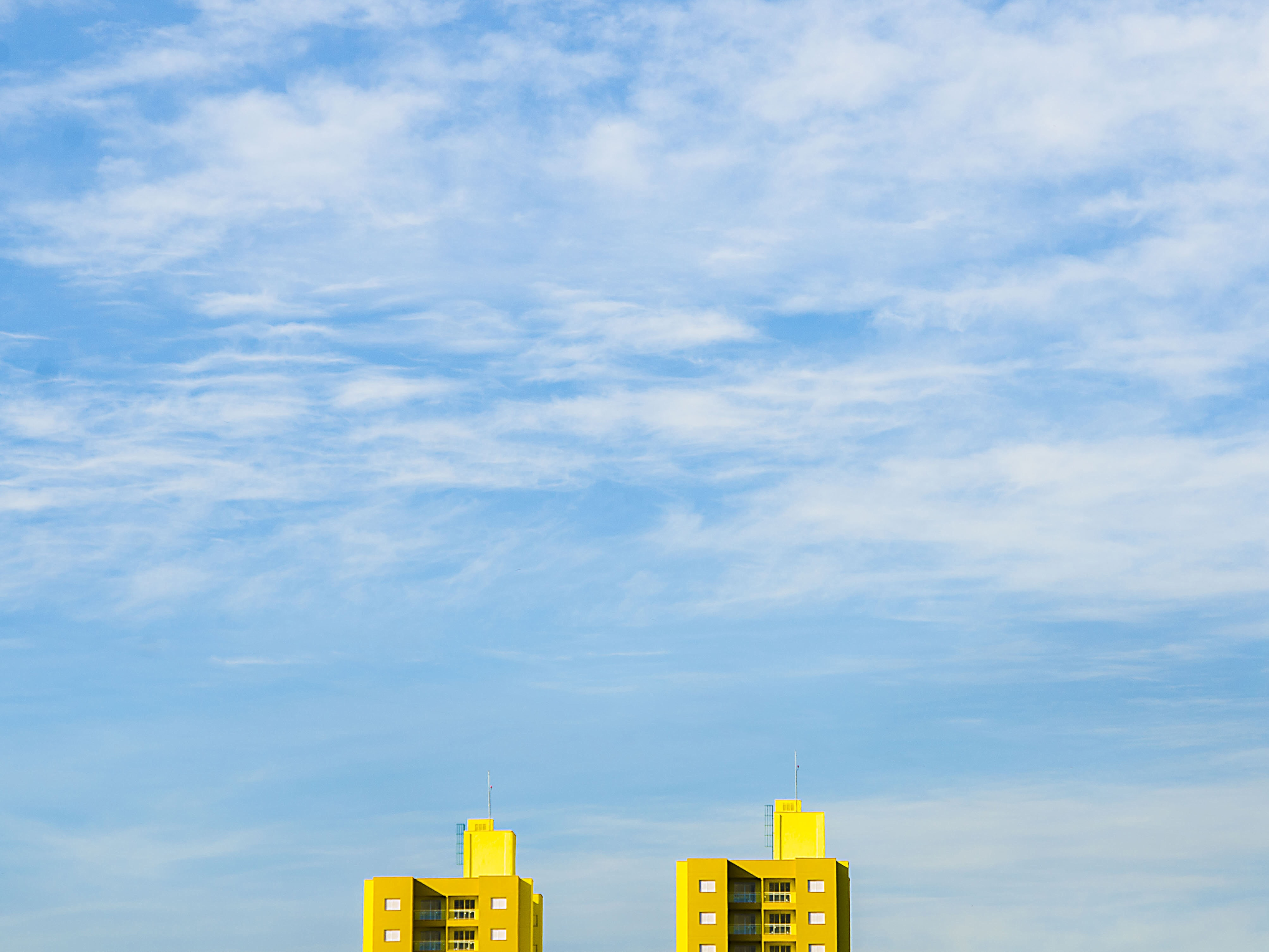 close up photography of two yellow buildings