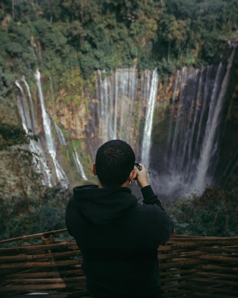 an holding camera capturing falls
