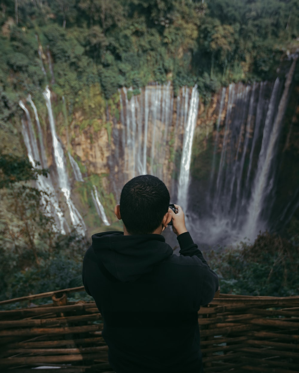 an holding camera capturing falls