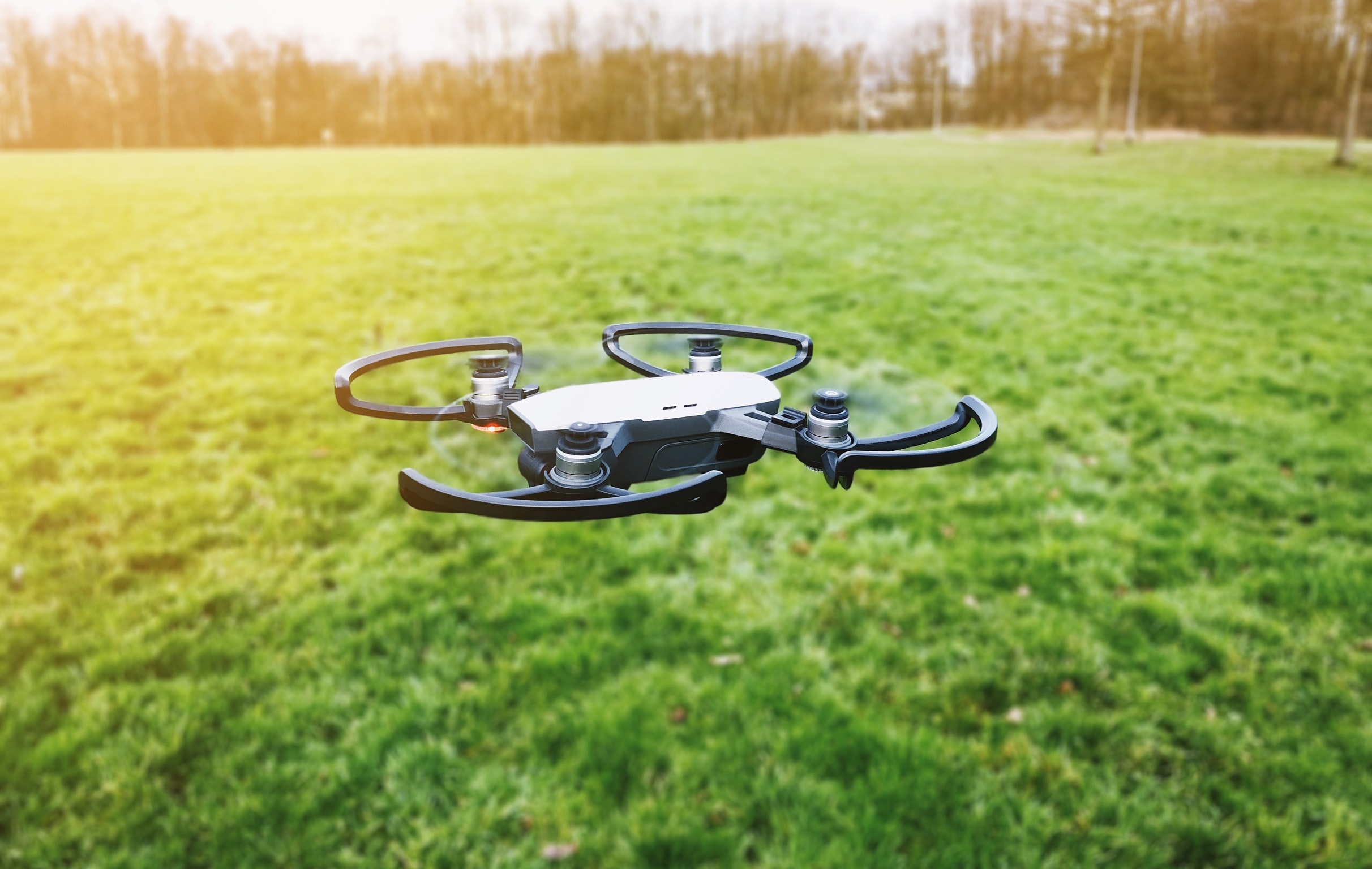 black quadcopter drone on open field