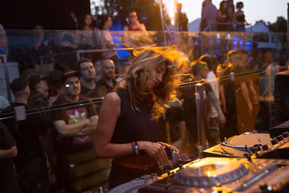 woman playing dj turntable
