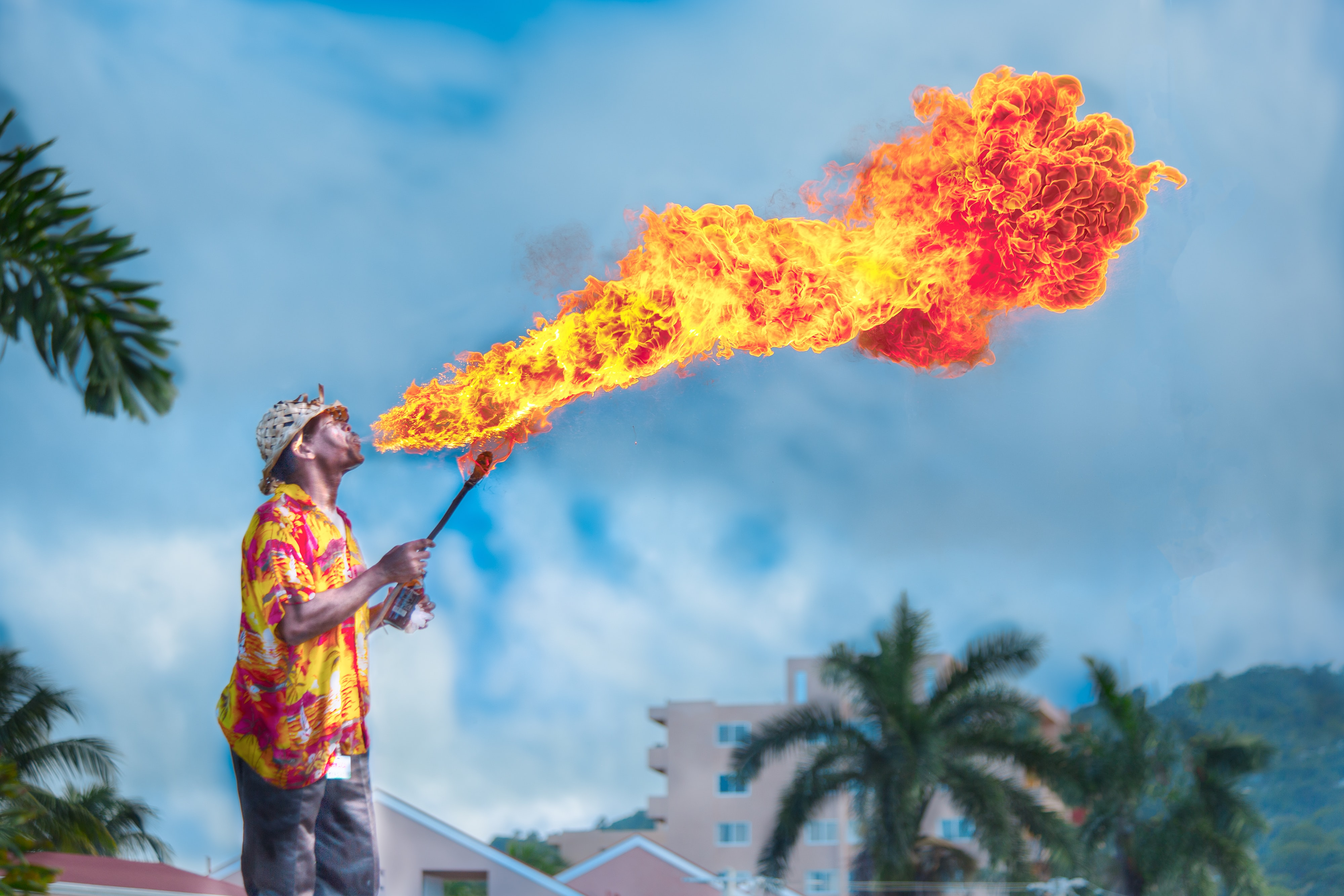 man blowing gas to make fire