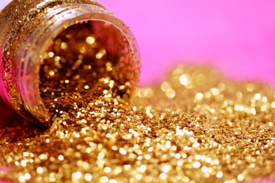 gold glitter with jar sparkle teams background