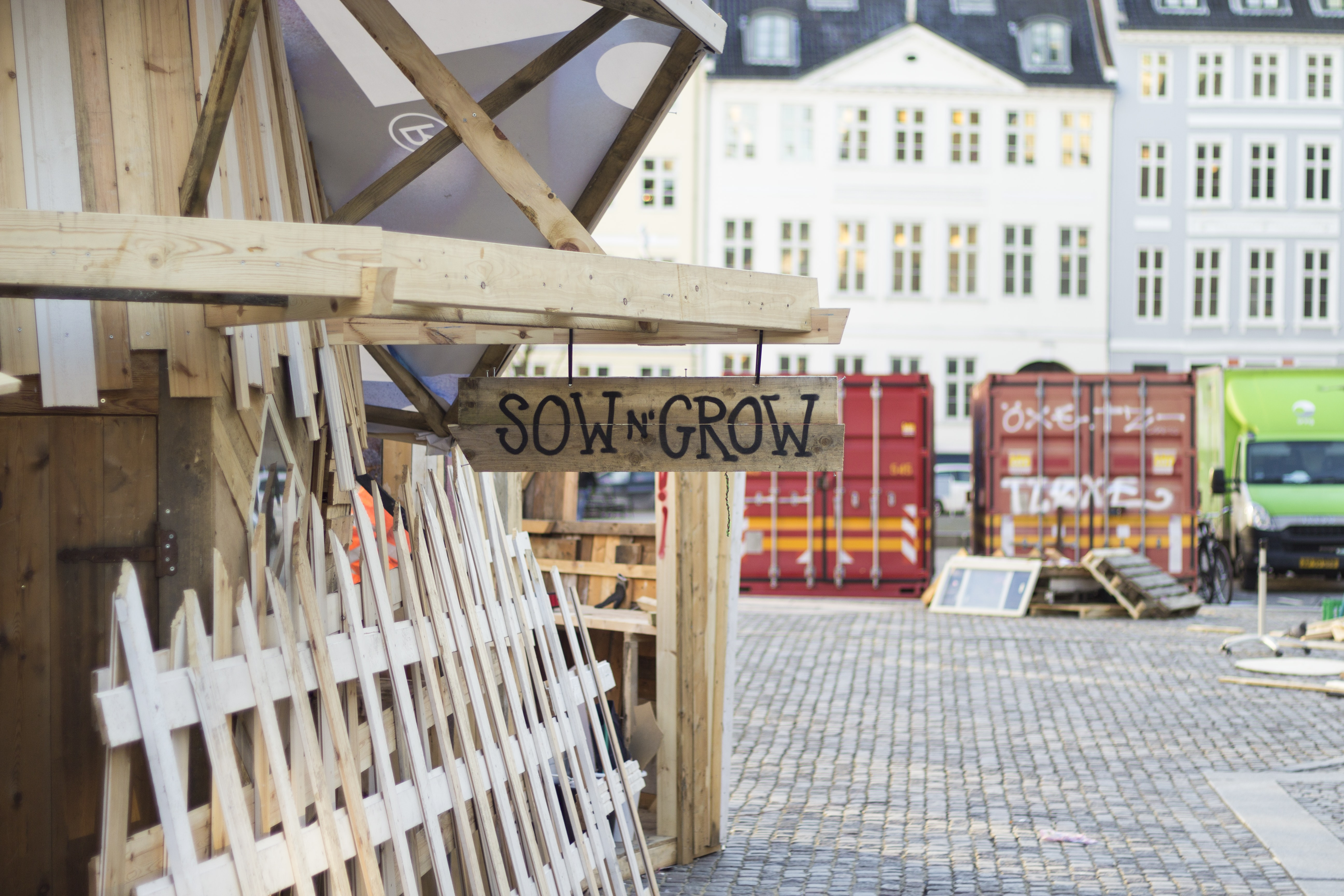 Sow N' Grow signage hanged on wooden log
