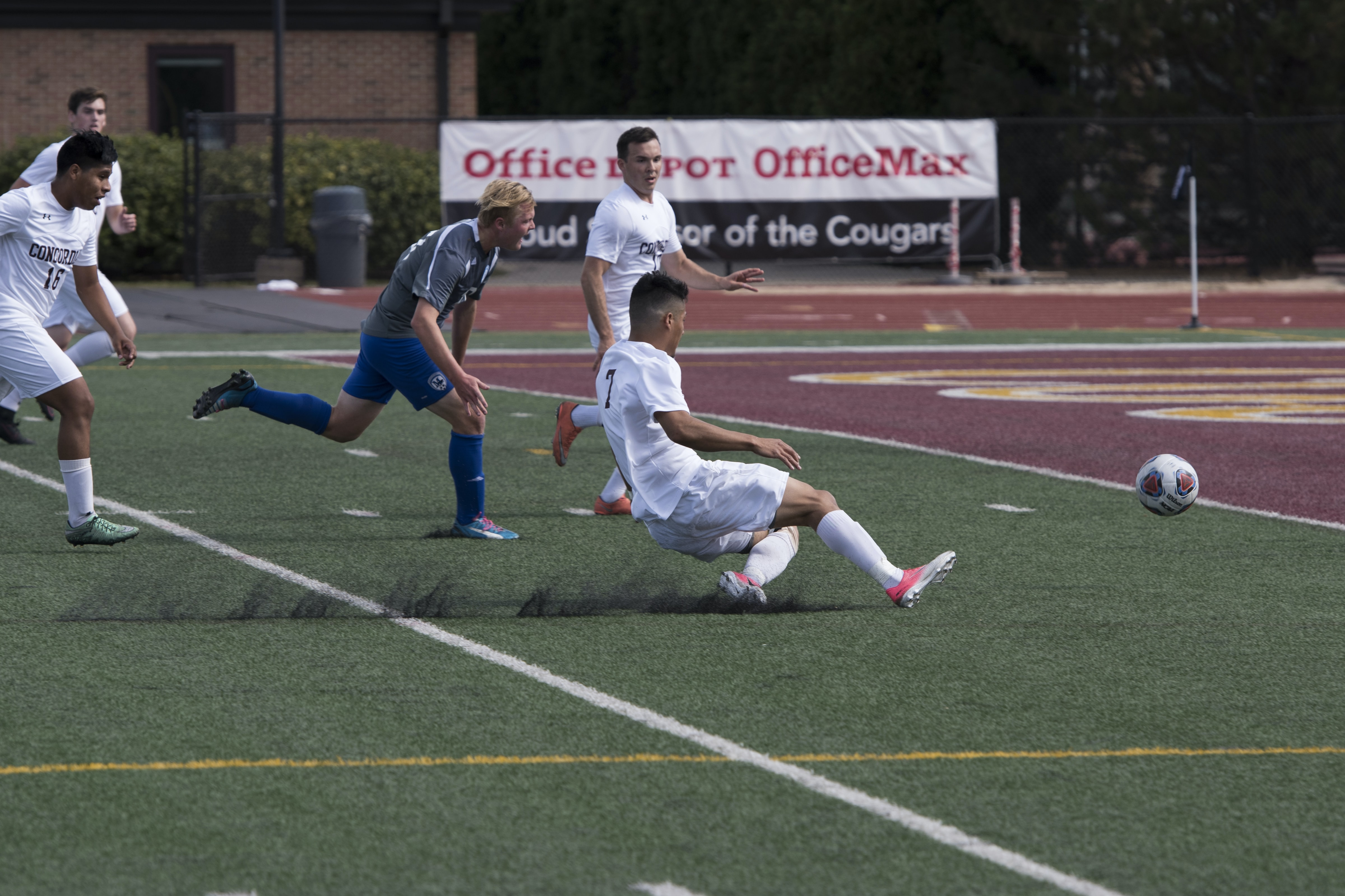 man near soccer ball on turf