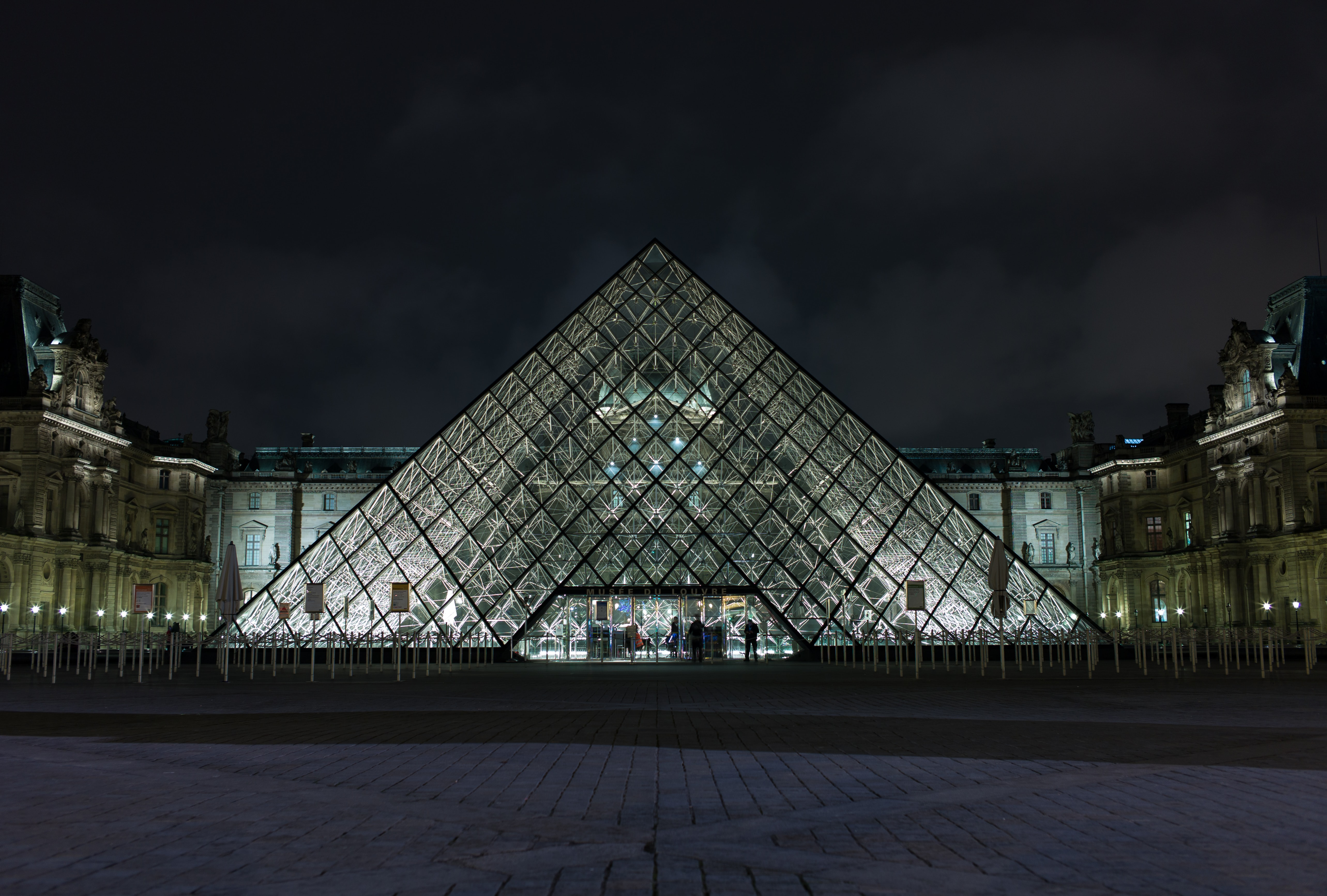 pyramid-shaped clear glass building during night