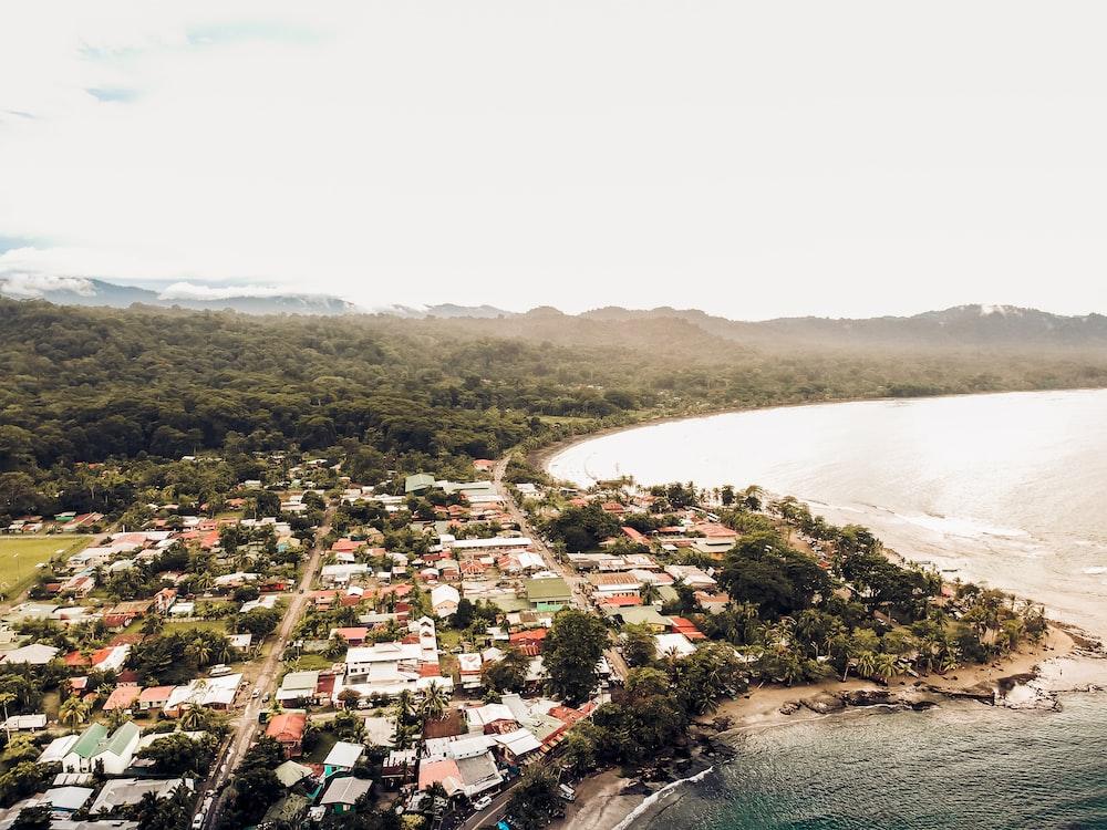 aerial photography of houses beside ocean