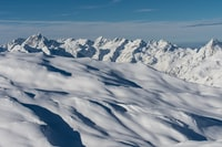 snow covered mountains at daytime