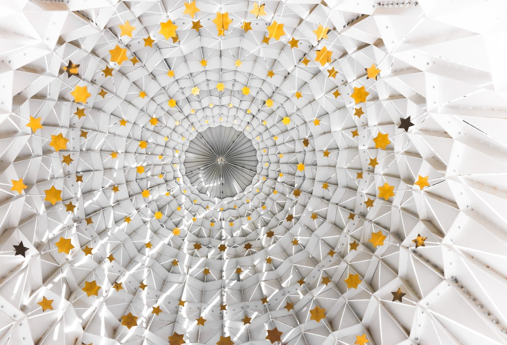 low angle photography of white and yellow dome