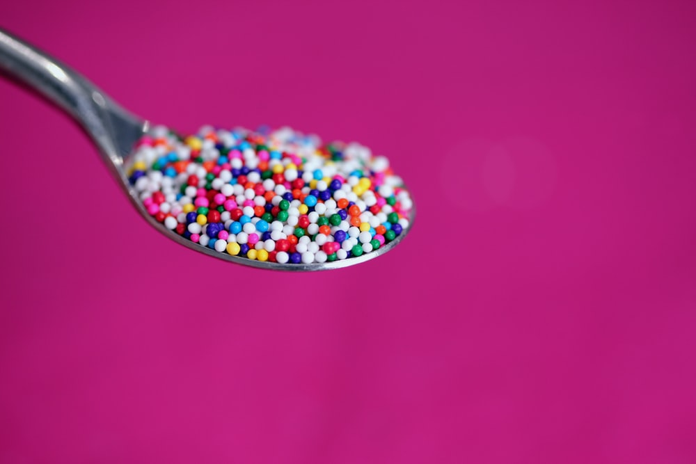 multicolored icing on stainless steel spoon