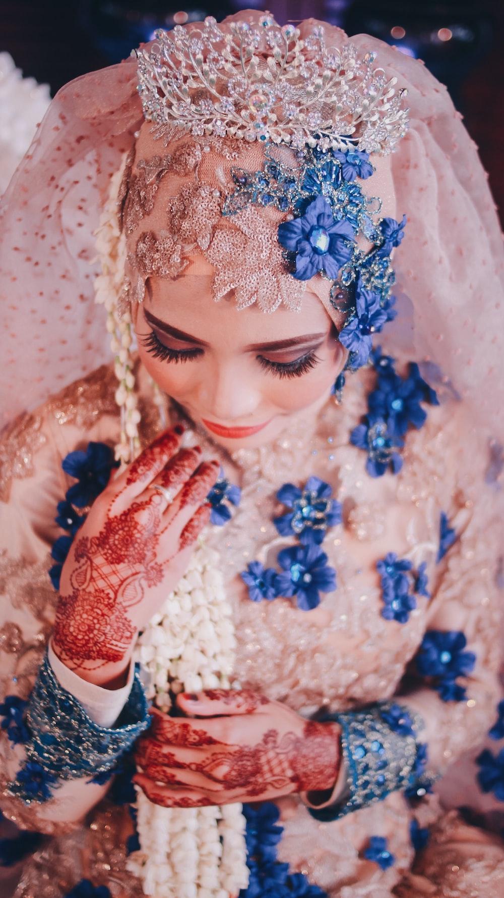 woman wearing pink and blue floral wedding abaya