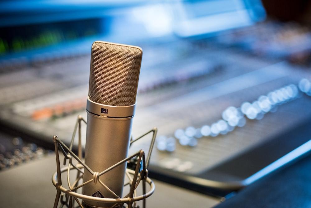 silver microphone near audio mixer